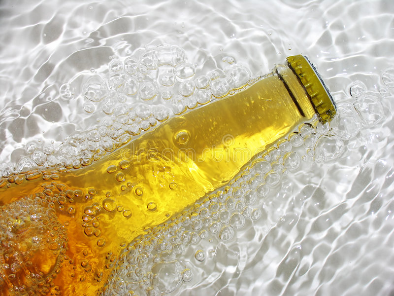 Bottle of beer. Fresh bottle of beer in cold water royalty free stock images