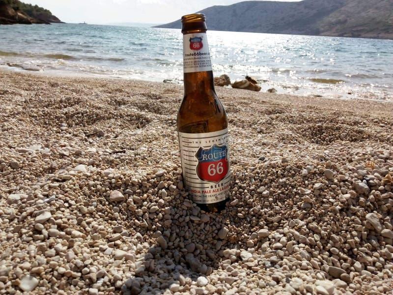Bottle of beer. Botlle of beer on beach royalty free stock image
