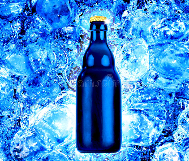 Bottle beer on fresh blue ice stock image
