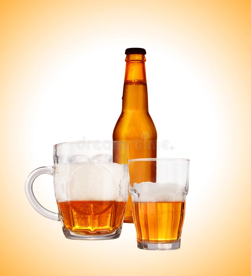 Bottle of beer with a beer mug. On a white background stock image