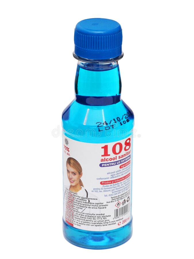 Bottle of blue medical alcohol - Spirt. A bottle of blue medical alcohol 108 Alcool Sanitar, isolated on white.  Picture taken on 14.03.2020 stock images