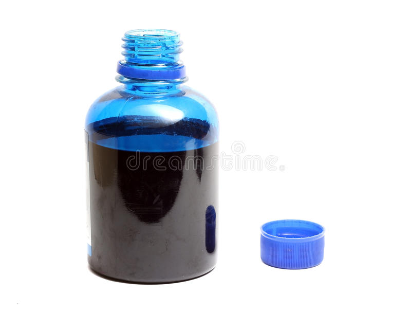 Bottle with blue paint isolated on white background royalty free stock images