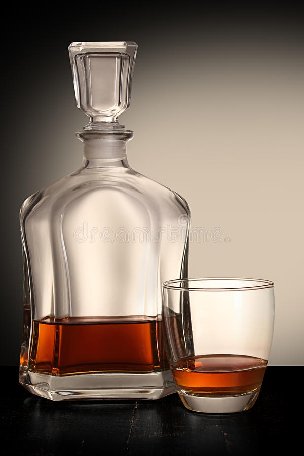 Bottle of brandy with glass stock images