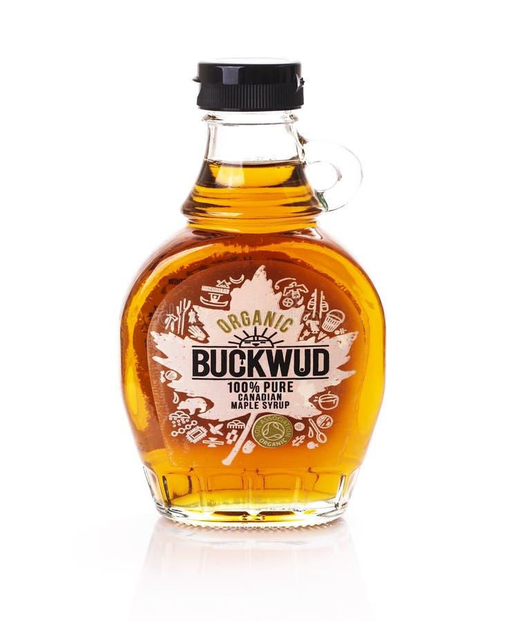 Bottle of Buckwud Organic 100% Maple Syrup on a white background. stock photography