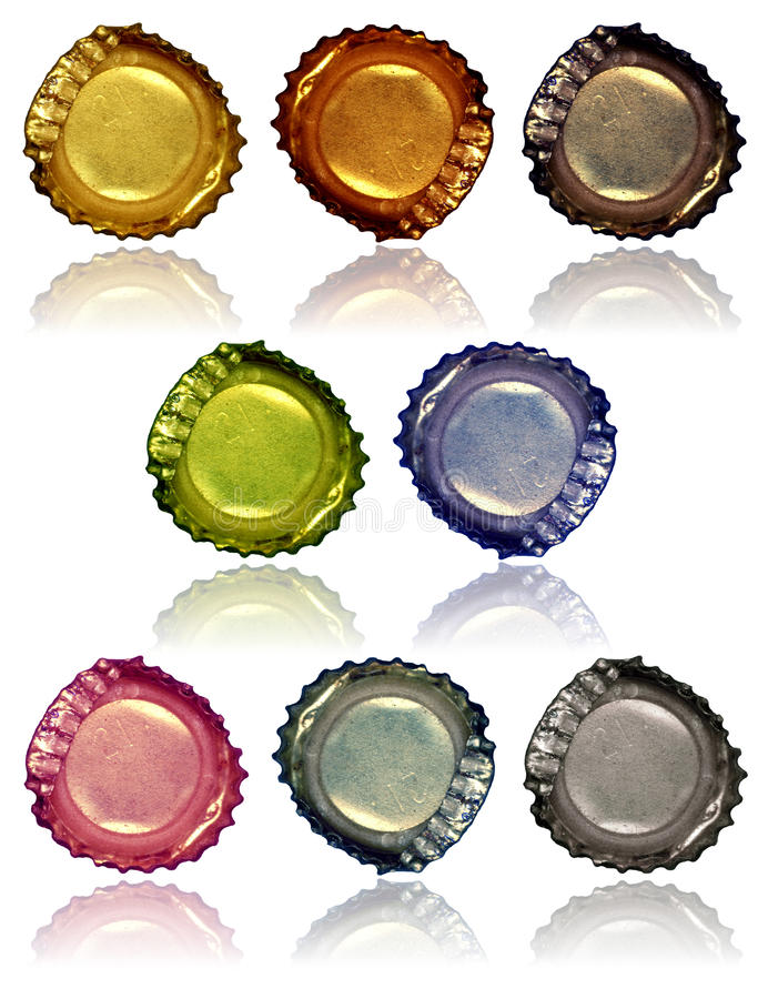 Bottle Caps 2. Various colored crushed bottle caps with reflections royalty free stock photos