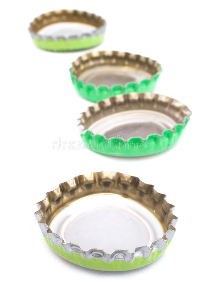 Bottle caps. Image of some bottle caps in line stock photography