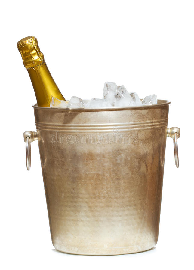 Bottle of Champagne in the bucket with ice. On the white background royalty free stock photo