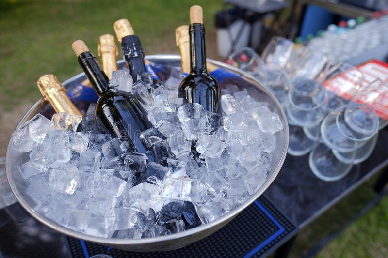 Bottle of champagne in bucket of ice. Bar counter. royalty free stock photos