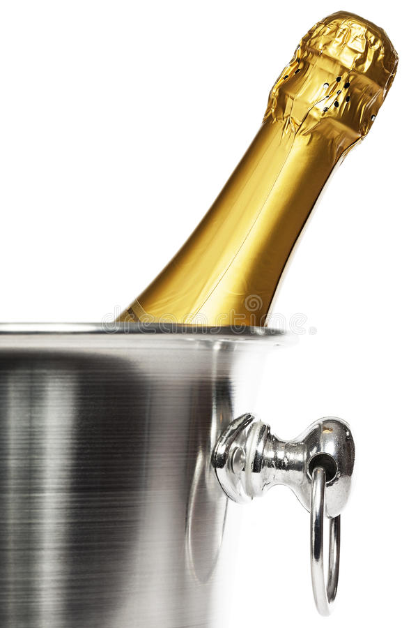 Bottle of champagne in a champagne bucket. Closeup of a bottle of champagne in a champagne bucket on white background stock photography