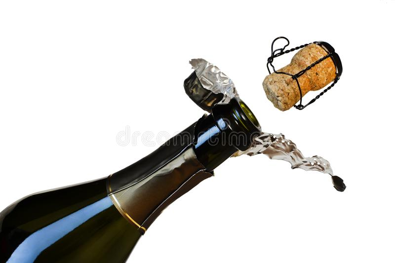 A bottle of champagne and a departing cork isolated on a white background stock photos