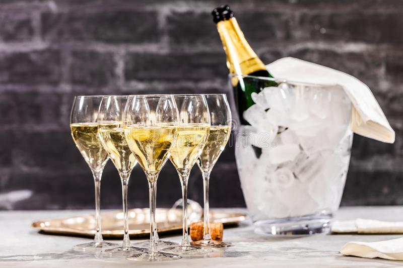 Bottle of champagne and filled glasses decorated in festive theme royalty free stock photos