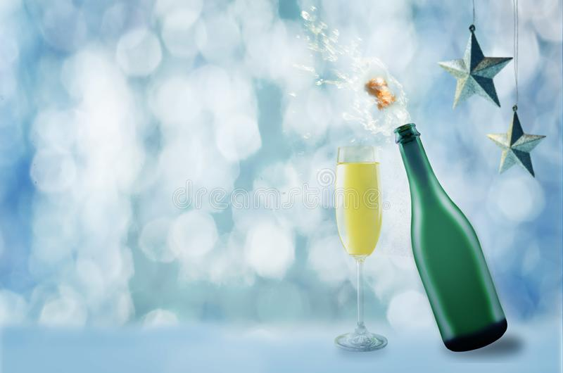 Bottle of champagne with a flying cork and spray stock photo