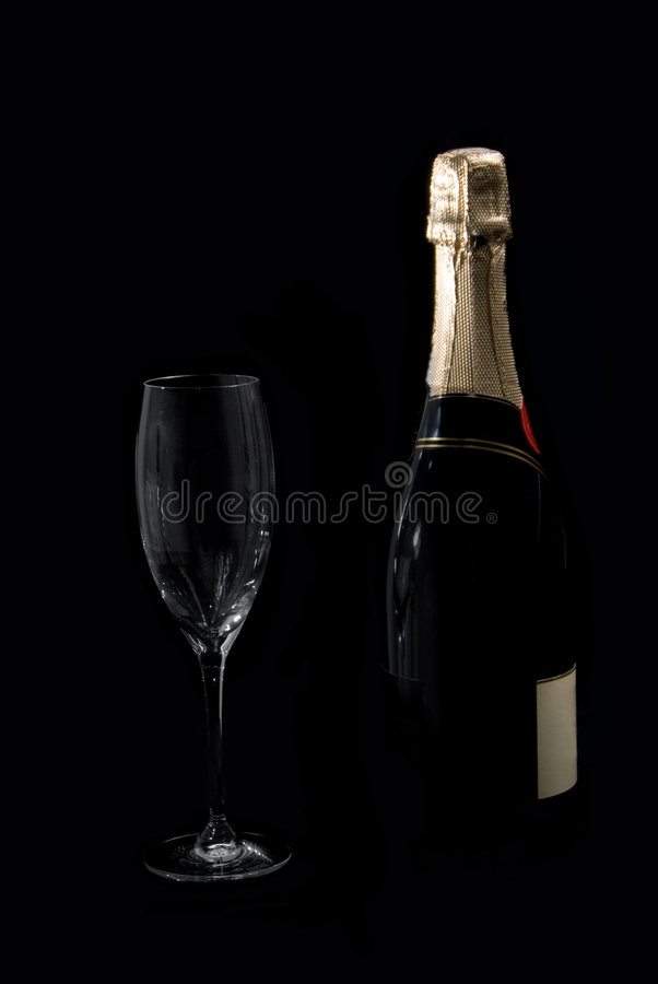 Bottle of champagne and glass royalty free stock images