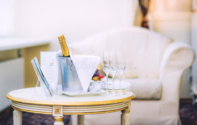 Bottle of champagne and glasses stock photo