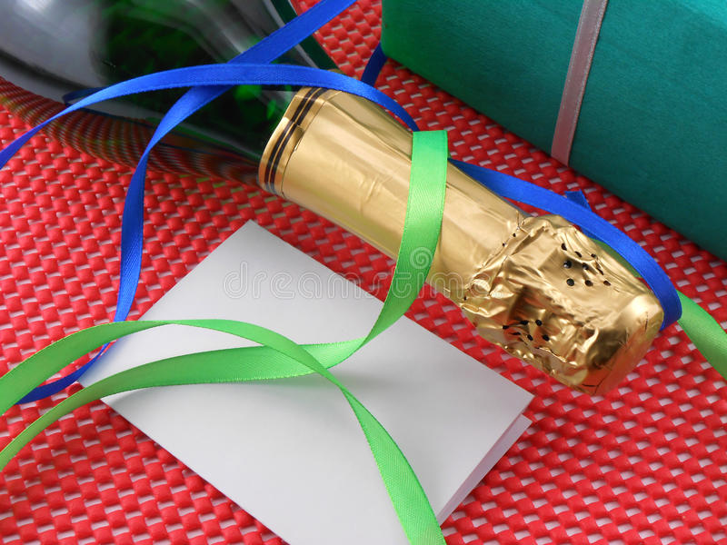 Download Bottle Of A Champagne And Green Gift Boxes Stock Photo - Image of liquid, drink: 35744622