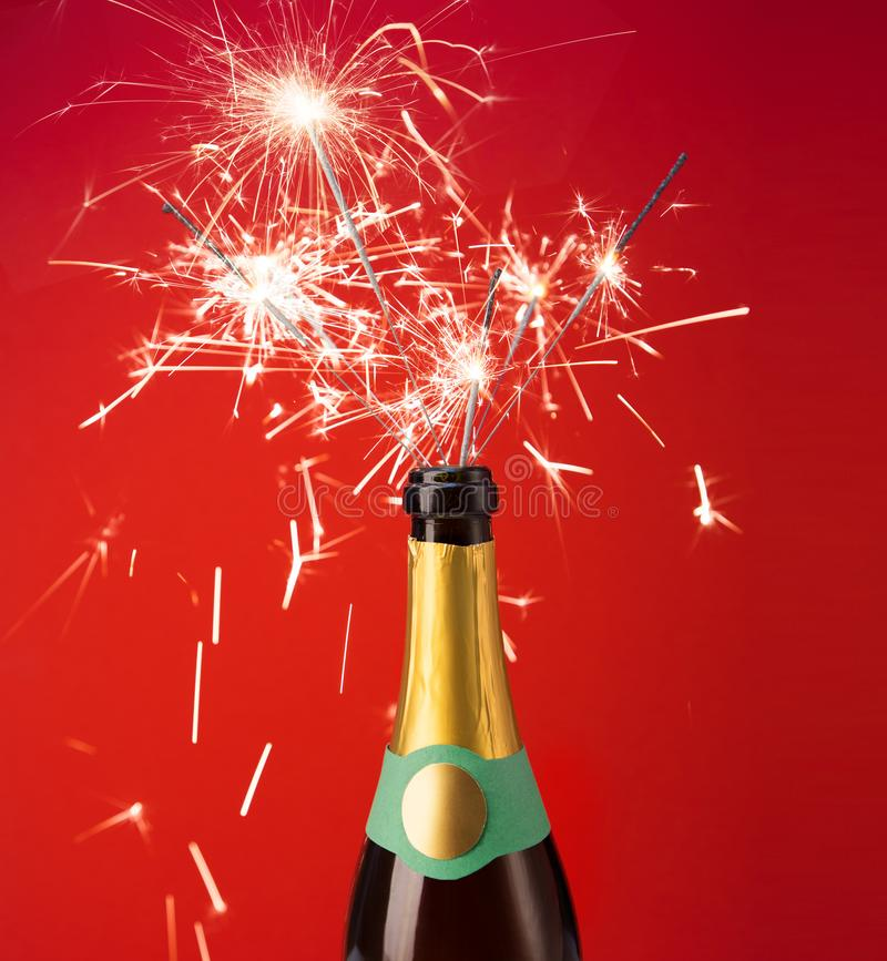 Bottle of champagne with sparklers inside stock photography