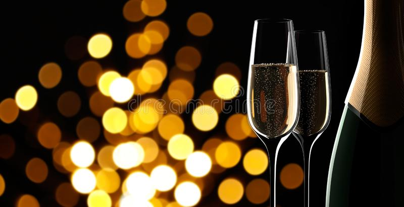Bottle of champagne with two glasses stock illustration
