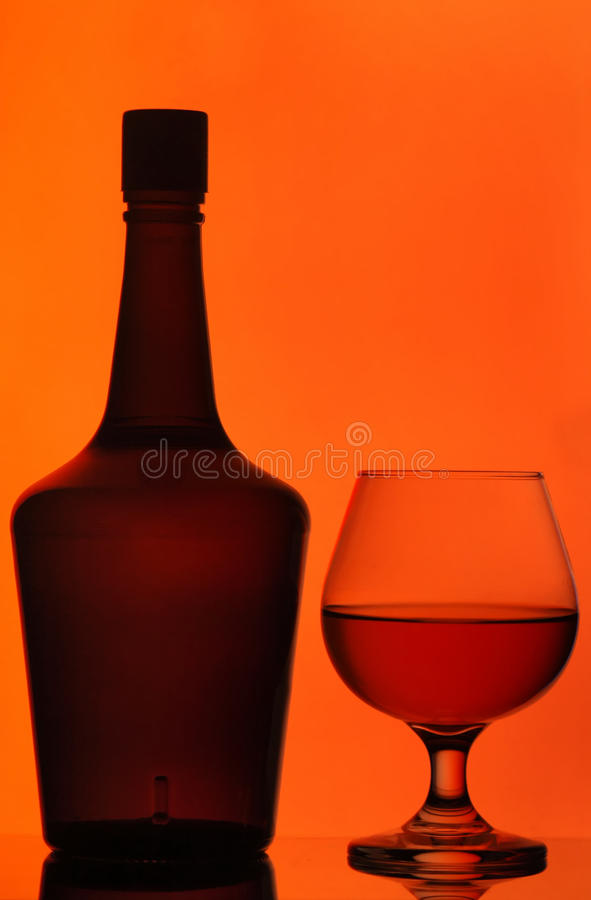 Bottle And Cognac Glass Stock Photos
