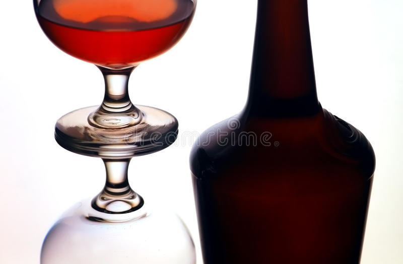 Bottle and cognac glasses stock photos