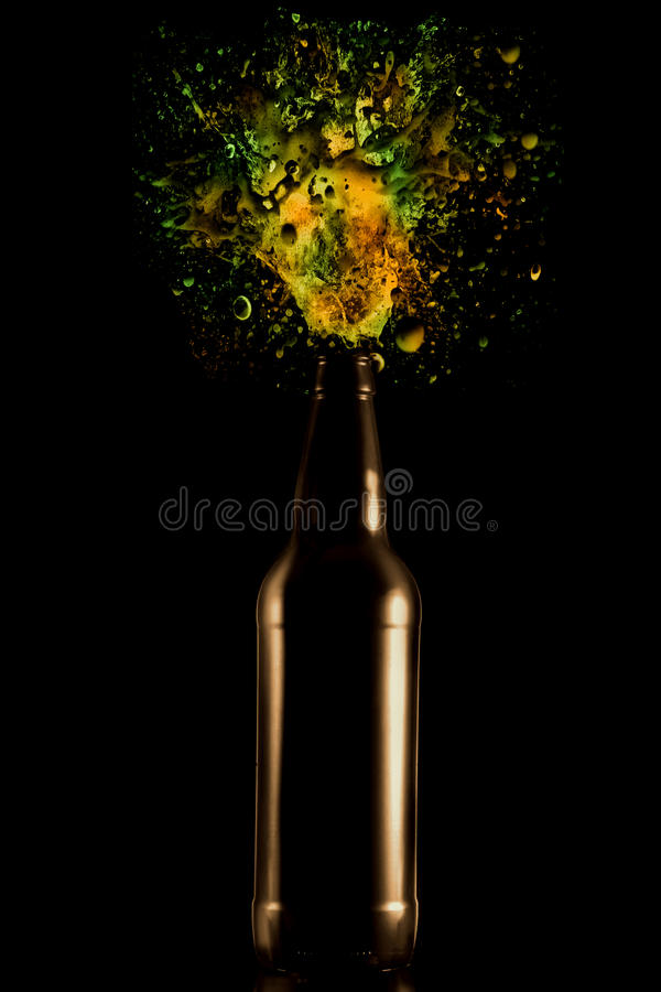 A bottle of beer with spray royalty free stock photos