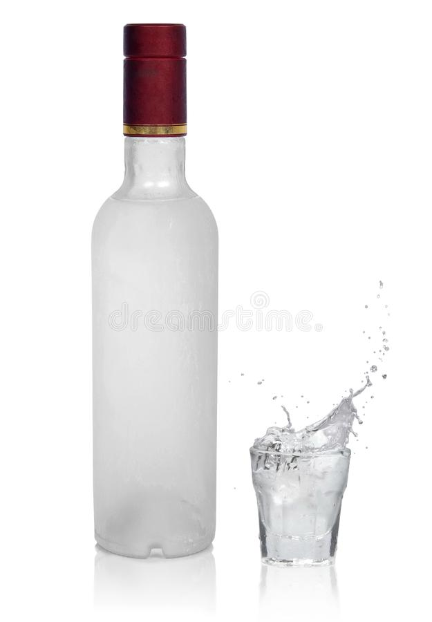 Bottle of cold vodka and glass with vodka stock photos