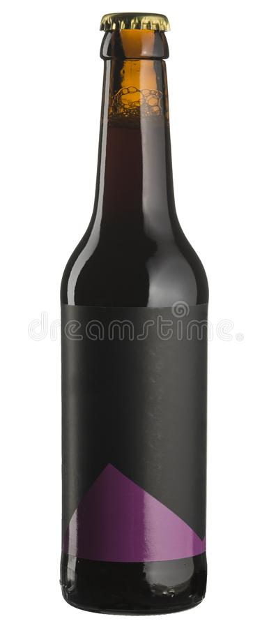 Bottle of dark beer with blank sticker isolated on white. royalty free stock photography