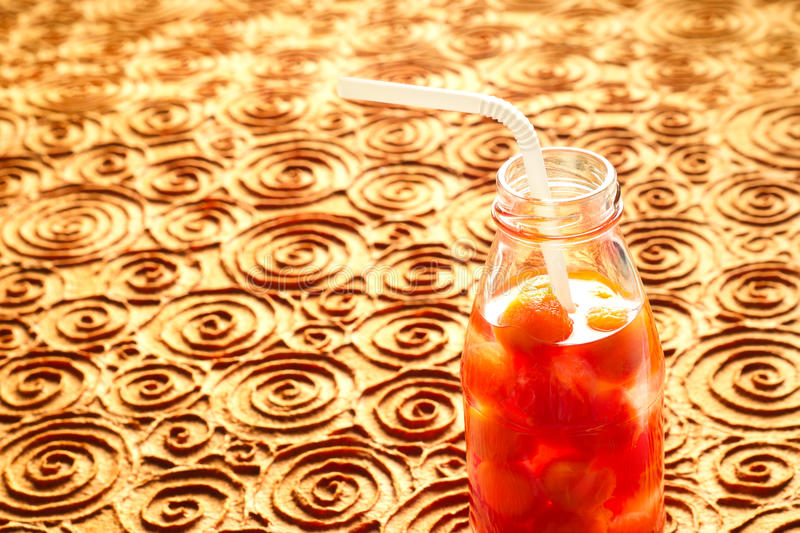 Bottle delicious refreshing drink of vibrant watermelon with drinking straw, infusioned water, soft focus and warm tone stock images
