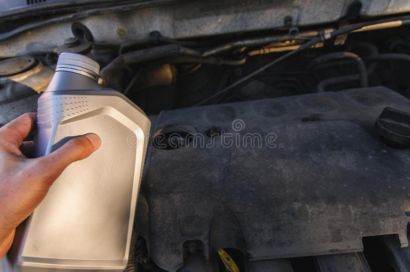 Bottle of engine oil on the background of the engine stock photo