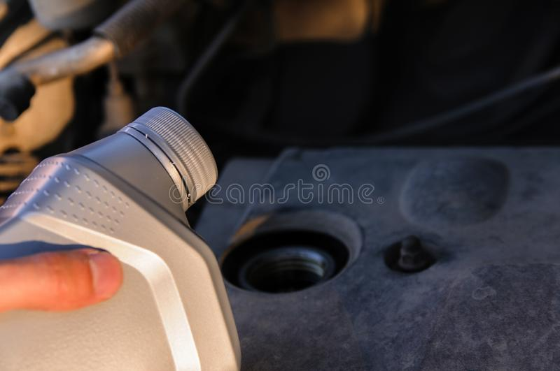 Bottle of engine oil on the background of the engine stock image