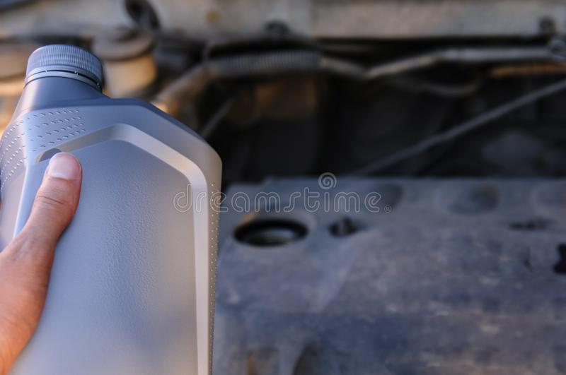 Bottle of engine oil on the background of the engine royalty free stock image
