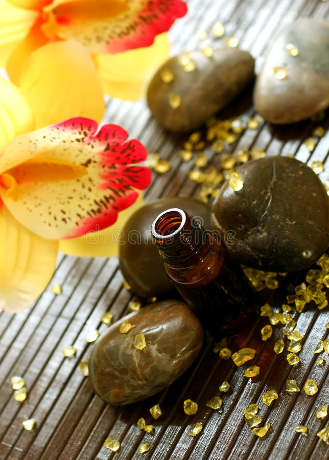 Download Bottle Of Essence Oil, Stones, Bath Salts And Flow Royalty Free Stock Images - Image: 18710259