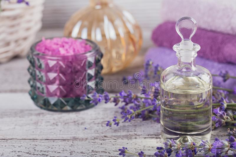 Bottle of essential oil and fresh lavender flowers stock image