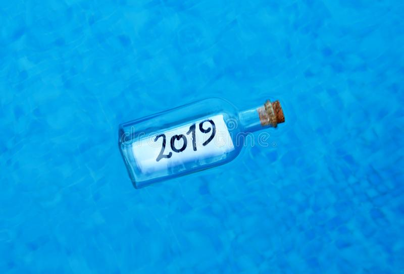 Happy New Year 2019, message in a bottle royalty free stock image