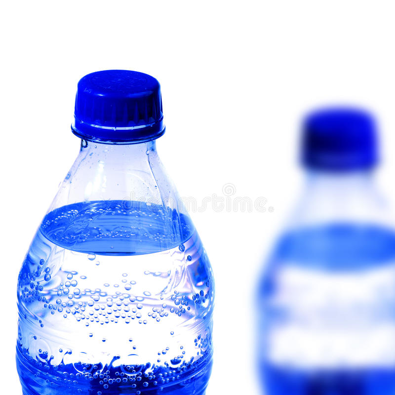 Bottle of Fresh Cold Water. Blur water bottle with white background royalty free stock photography