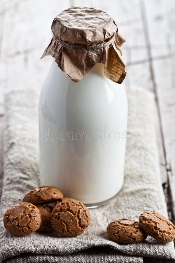 Bottle of fresh milk and almond cookies royalty free stock photos