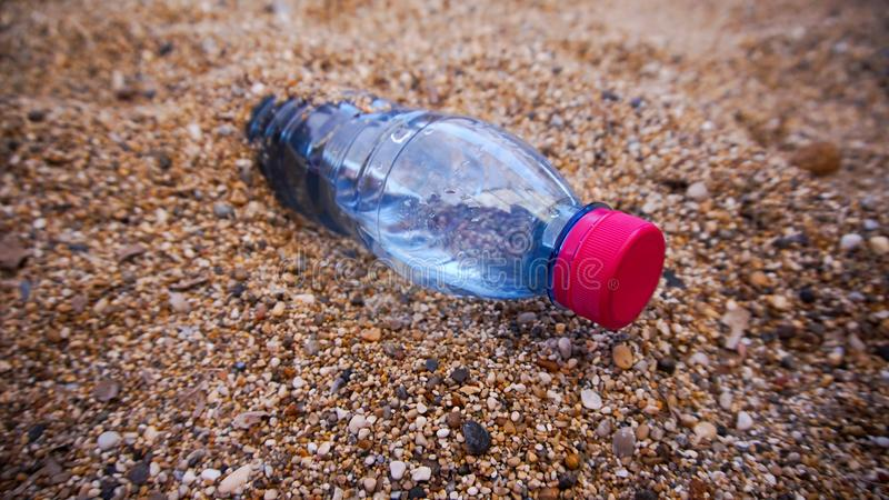 Download Plastic bottle in the sand stock photo. Image of beverage - 99586788