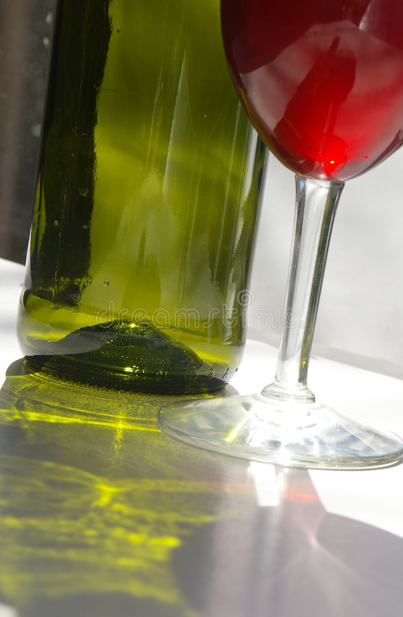 Bottle and glass stock photography