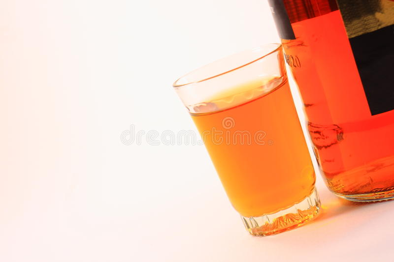 Bottle and glass with alcohol. Great bottle and glasses with brown alcohol royalty free stock photos