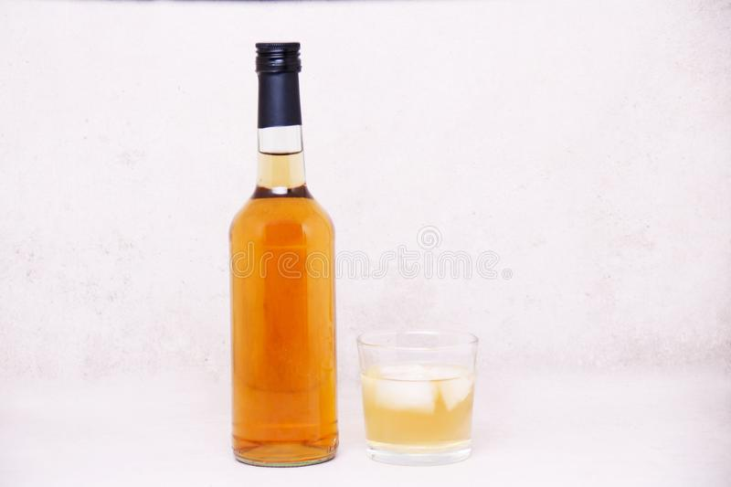 A bottle and a glass of alcoholic Drink, cheers stock image