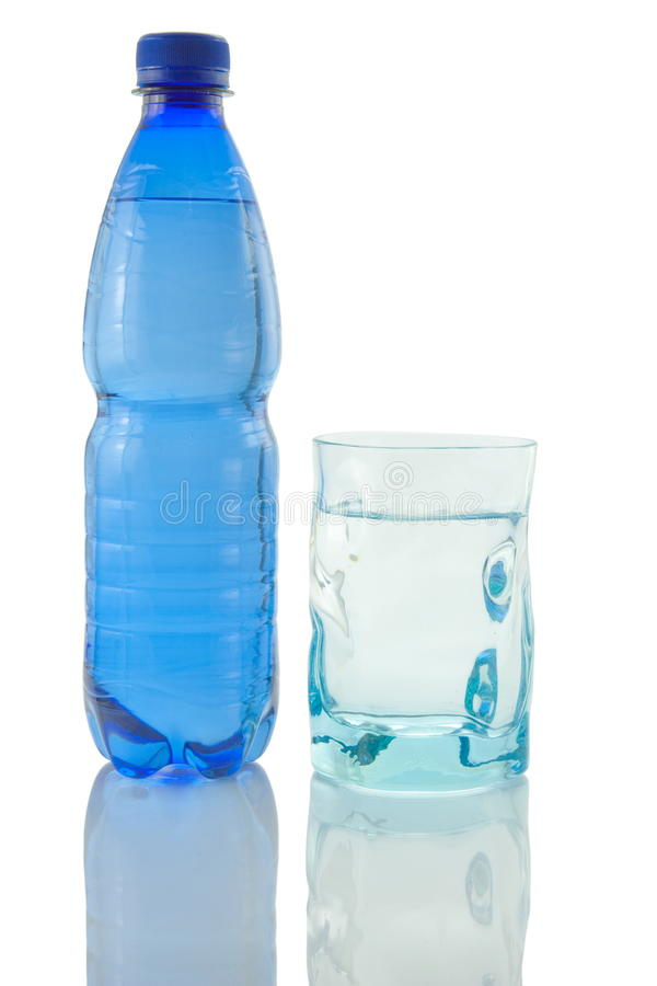 Bottle and glass of mineral water. Reflected on white background royalty free stock photography