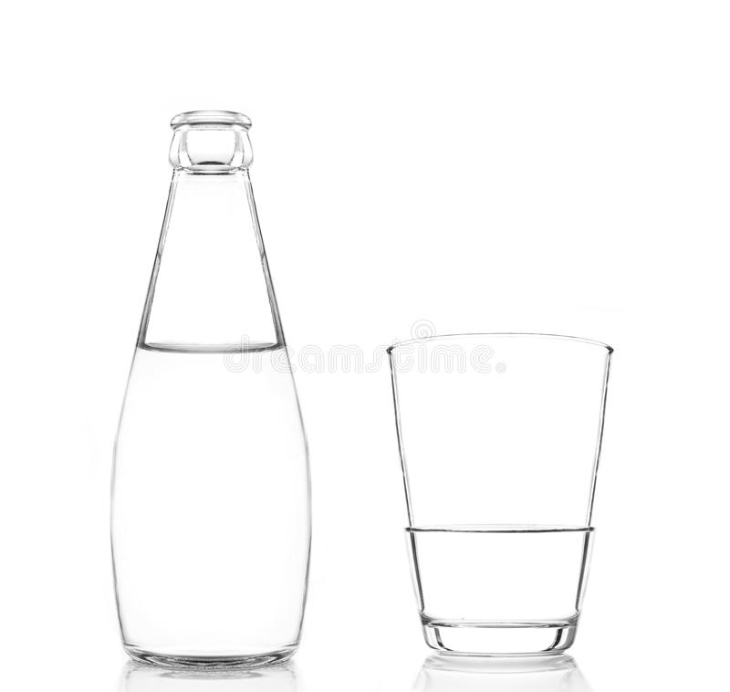 A bottle and a glass of pure fresh water isolated