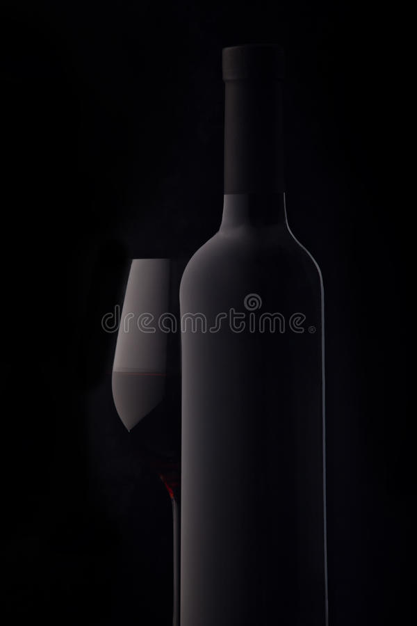 Bottle and a glass of red wine royalty free stock photography