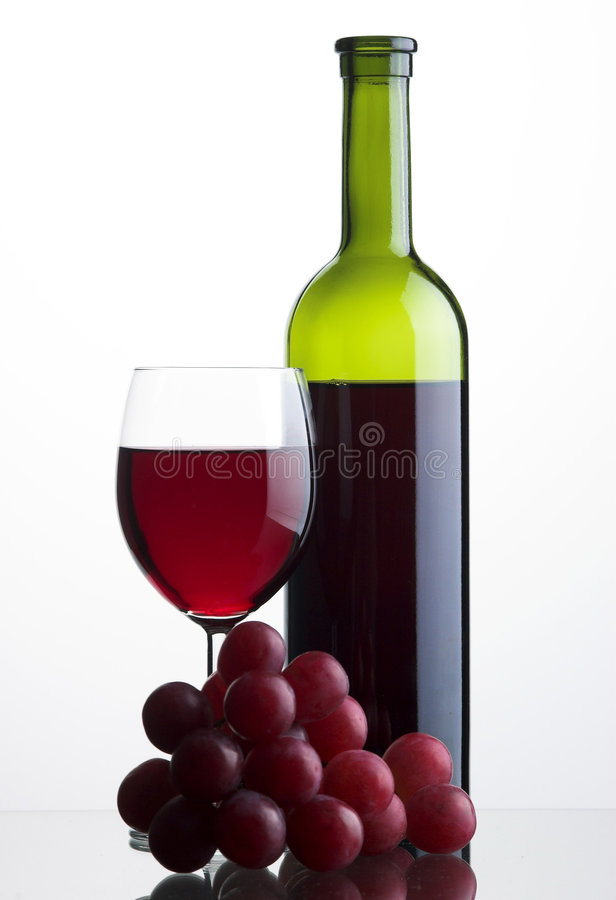 Bottle And Glass Of Red Wine With Grapes Stock Photos