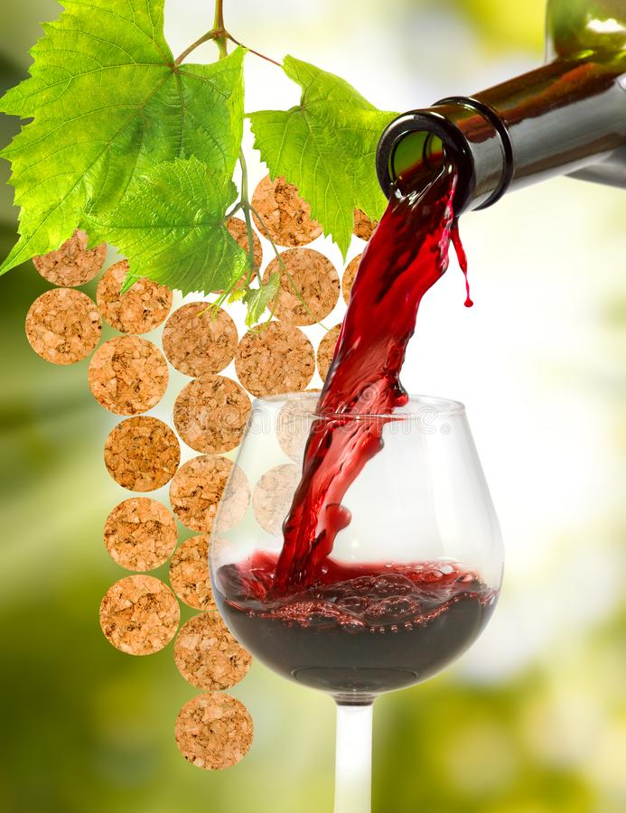 bottle and a glass of wine on a blurred background stock photography