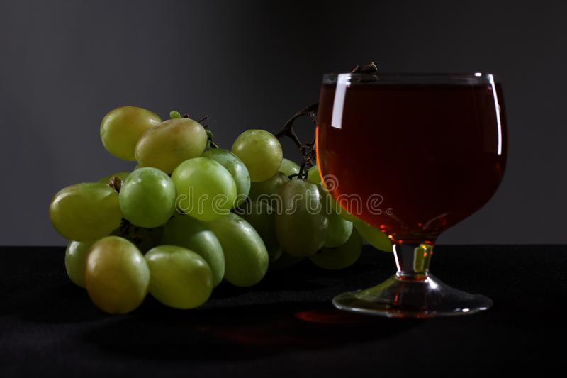 Grapes and wineglass on black two stock photo