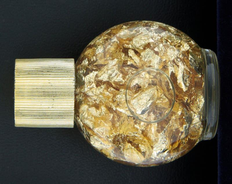 Bottle of Gold Foil Shreddings royalty free stock photos