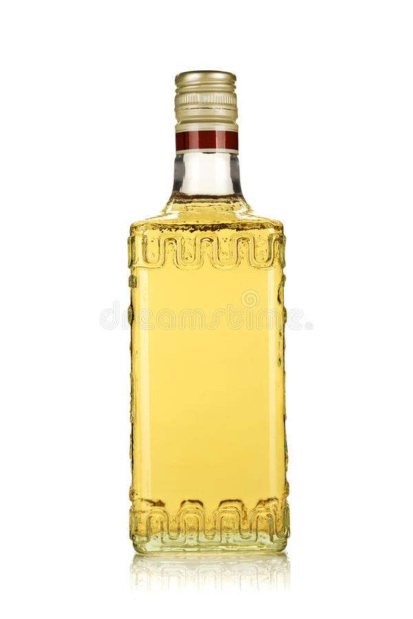 Bottle of gold tequila royalty free stock image