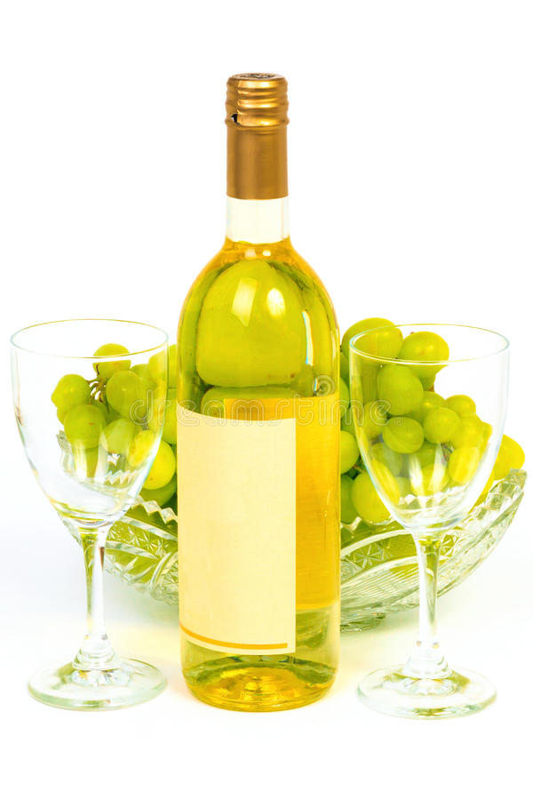 Bottle and grape in crystal vase stock image