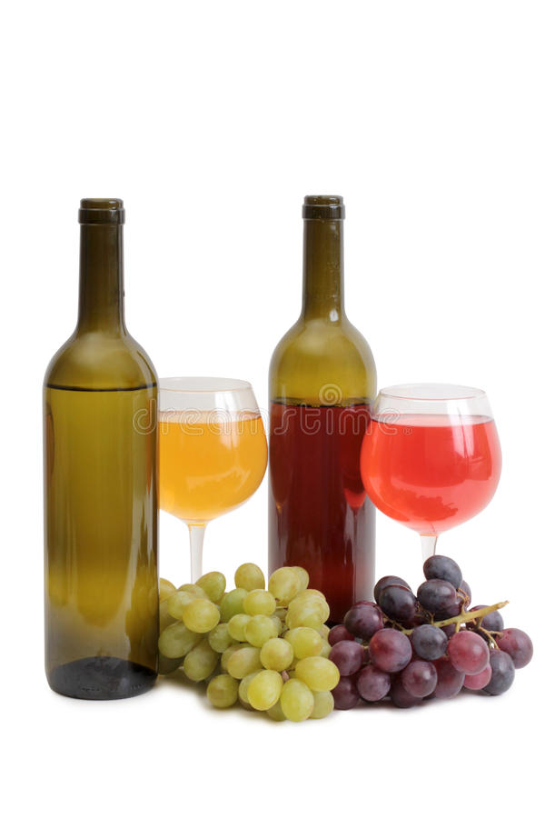 Bottle and grapes stock photography