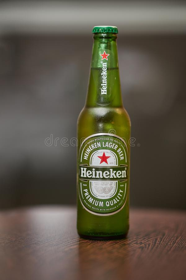 Bottle of Heineken beer. BUDAPEST, HUNGARY - DECEMBER 20, 2018: Bottle of Heineken on a table. Heineken is a Dutch brewery company founded in 1864 stock photos